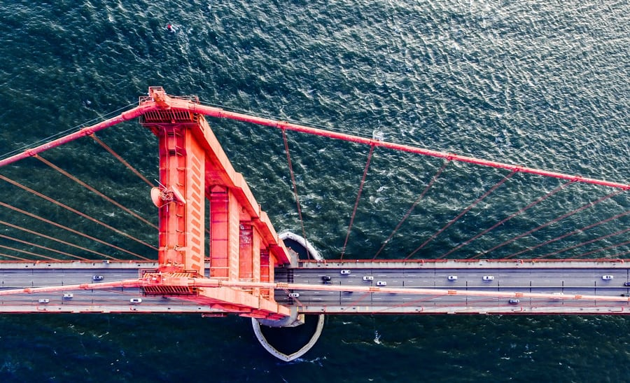 drone photography of red steel bridge