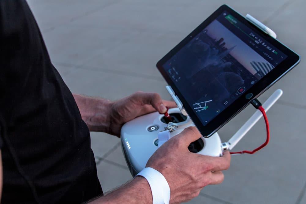 men holding drone controller