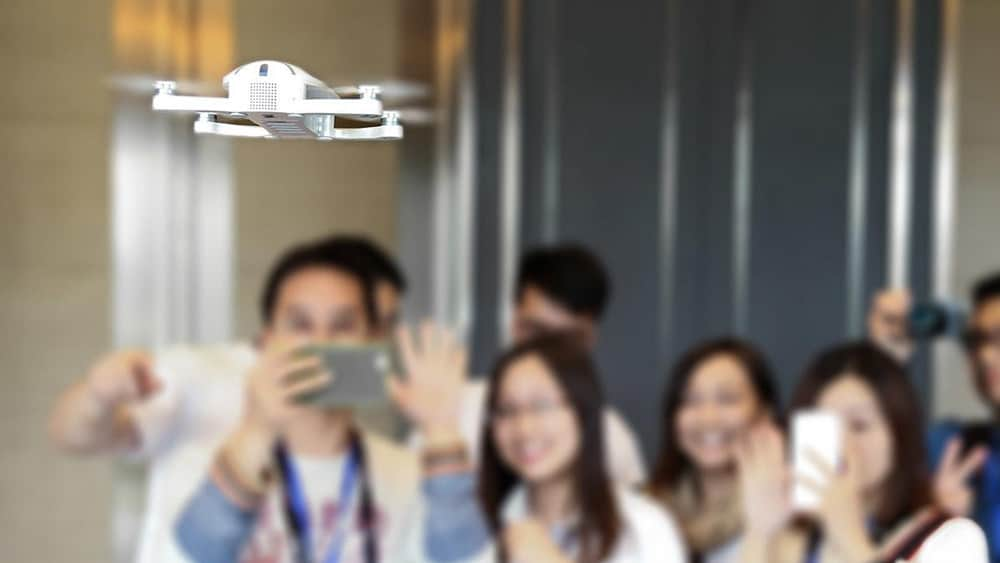 Group of people taking a selfie using a drone