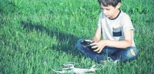 Kid Playing With A Drone