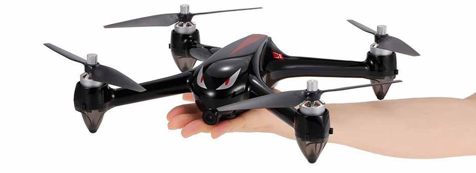 MJX Bugs 2w drone on palm