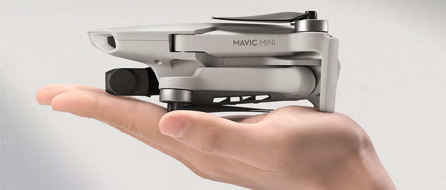 Holding DJI Mavic Mini in hand
