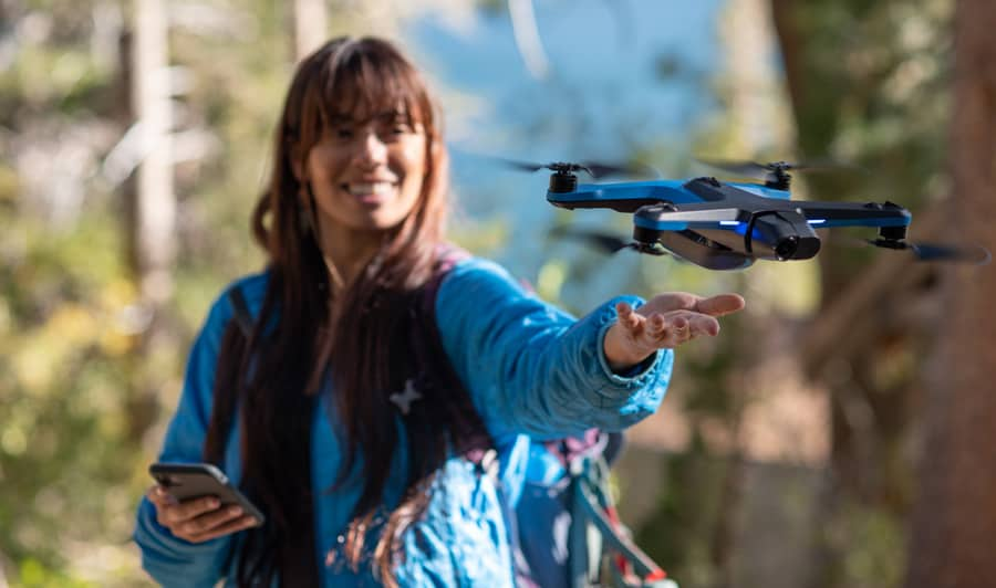 Girl holding Skydio 2 drone in a hand
